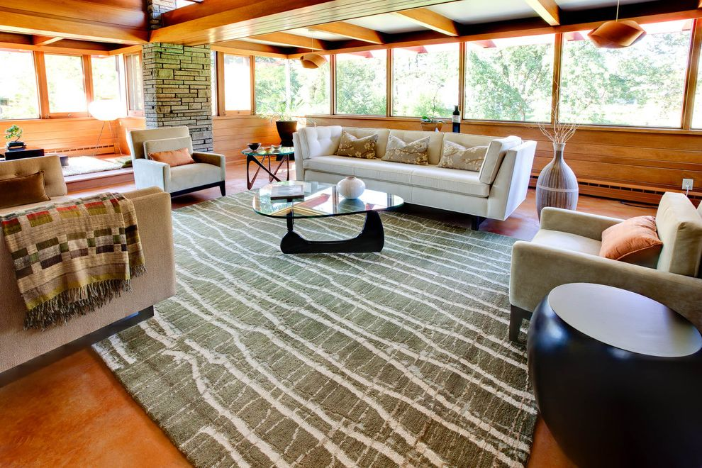 10 by 13 Rugs with Midcentury Living Room Also Large Windows Moss Green Rug Noguchi Coffee Table Noguchi Table Lamp Off White Sofa Prairie Style Round Side Table Sofa Stone Chimney Tan Sofa Usonian Warm Wood Wood Beam Wood Panel