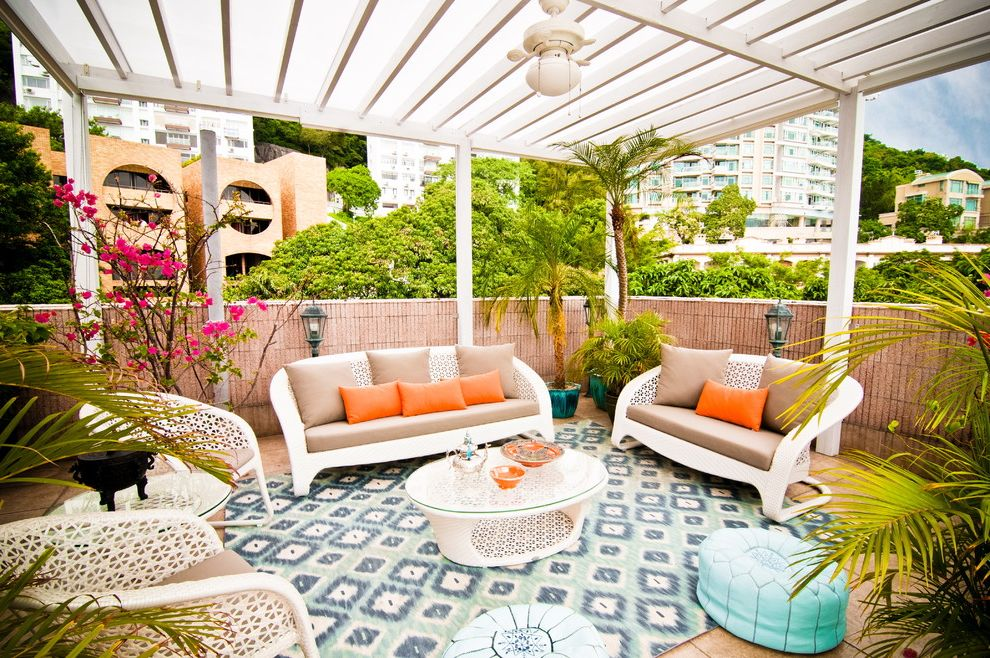 10x12 Outdoor Rug with Tropical Patio  and Area Rug City Flat Weave Garden Wall Glass Topped Coffee Table Lanterns Leather Pouf Light Blue Orange Seat Cushions Pergola Perspex Uv Waterproofing Tropical Plants Urban Woven Outdoor Furniture