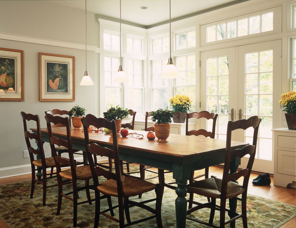 12 Foot Farm Table   Traditional Dining Room  and Baseboards Corner Windows Dining Table Centerpiece Farmhouse Table French Doors Gray Walls High Ceilings Pendant Lighting Rush Seat Chair Tall Ceilings Transom White Wood Wood Flooring Wood Trim