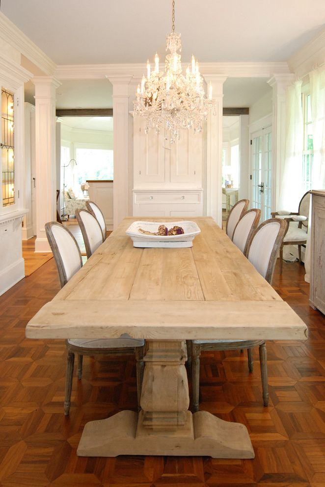 12 Foot Farm Table with Shabby Chic Style Dining Room  and Centerpiece Chandelier Crown Molding French Louis Chairs Neutral Colors Parquet Flooring Shabby Chic Trestle Table Upholstered Dining Chairs White Wood Wood Flooring Wood Trim