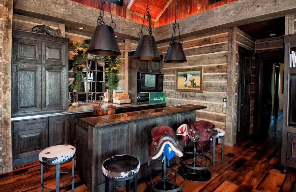 24 Inch Saddle Bar Stools with Rustic Home Bar  and Bar Barnwood Brown Cabin Chinking Earth Tones Home Bar Island Old Pendant Light Reclaimed Recycle Stool Tall Ceiling Timber Vaulted Ceiling Wood Beams Wood Cabinets Wood Floor