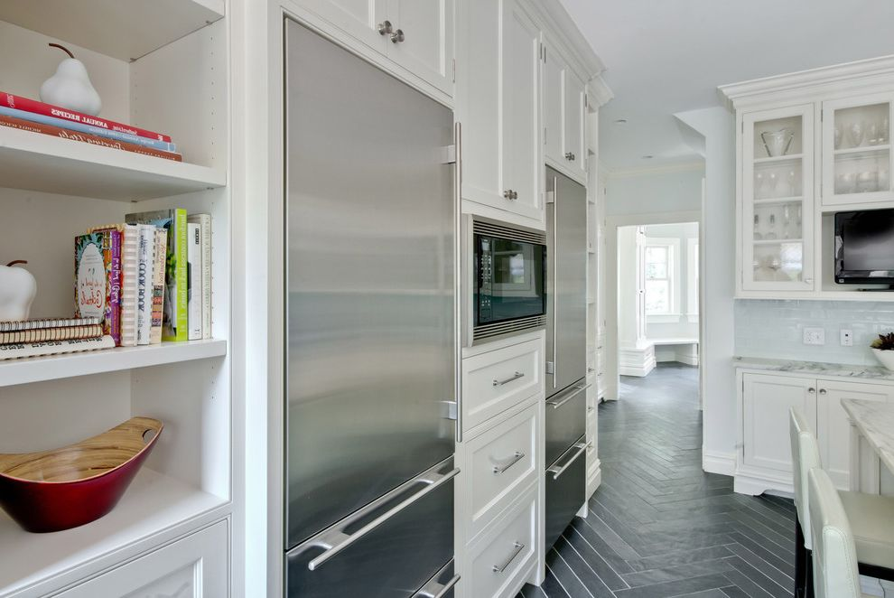 26 Inch Depth Refrigerator with Victorian Kitchen and Built in Shelves Built in Storage Chevron Dark Floor Glass Front Cabinets Herringbone Pattern Kitchen Shelves Stainless Steel Appliances Tile Floor White Kitchen