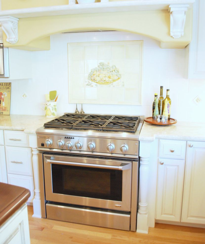 36 Gas Range with Griddle with Traditional Kitchen  and Backsplash Corbels Hardwood Floor Hood Shelf Painted Tile Mural Pale Yellow Stainless Steel Gas Range White Kitchen