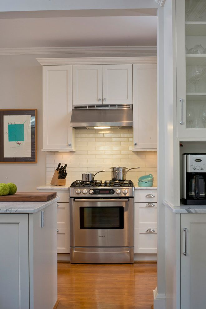 36 Range Hood Insert with Traditional Kitchen Also Aidan Design Alpine White Brookhaven Cabinetry Custom Cabinetry Edgemont Door Style Honed Cararra Marble Shaker Kitchen Small Kitchen Subway Tile Tiled Backsplash Urban Kitchen Woodmode Cabinetry
