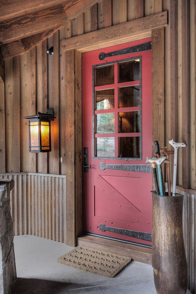 36 X 84 Exterior Door with Traditional Entry  and Board and Batten Cabin Corrugating Metal Lantern Lantern Doormat Lodge Outdoor Lighting Red Door Rustic Door Hardware Umbrella Stand Wainscoting Wood Siding