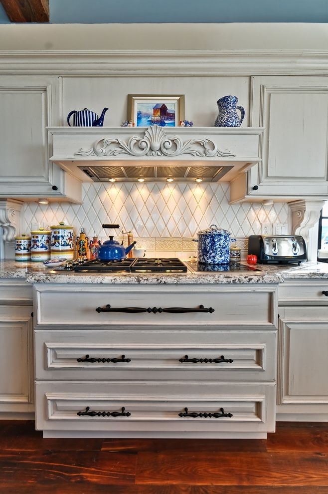 40 Gas Stove   Mediterranean Kitchen Also Dark Floor Distressed Finish Granite Countertops Kitchen Hardware Range Hood Rustic Tile Backsplash Under Cabinet Lighting White Cabinets White Kitchen Wood Cabinets Wood Flooring