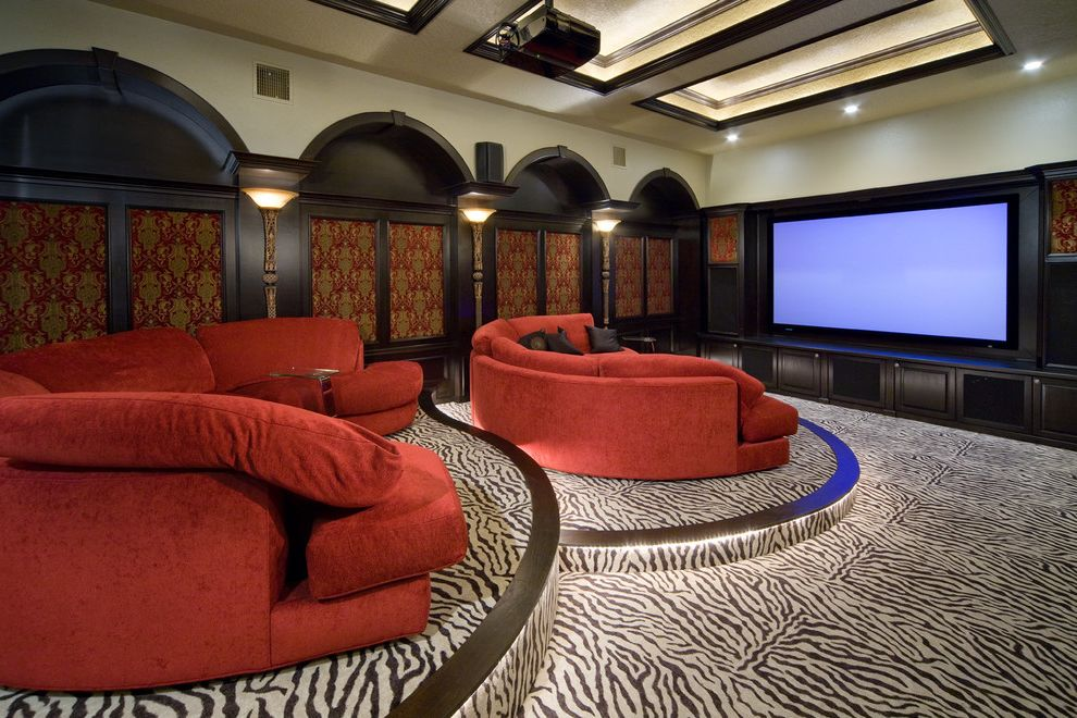 40th Street Movie Theater   Traditional Home Theater  and Home Theater Oversized Sofa Projector Red Sectional Red Sofa Stadium Seating Zebra Print Carpet