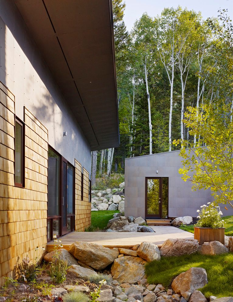 40x60 Metal Building with Living Quarters   Contemporary Exterior Also Boardwalk Boulders Butterfly Roof Cladding Corner Window Deck Glass Windows Grass Large Windows Metal Roof Modern Rustic Overhang Patio Pine Trees Planter Shingles Stone Path