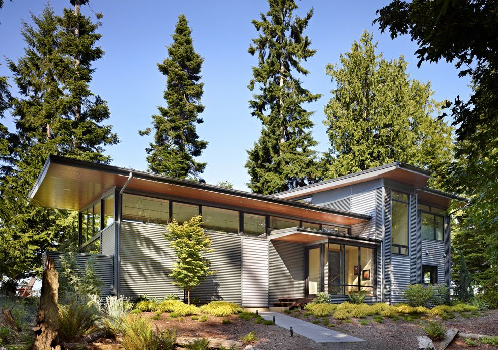 40x60 Metal Building with Living Quarters   Modern Exterior Also Clerestory Windows Flat Roof Gray Siding Horizontal Siding Large Eaves Large Overhangs Large Windows Metal Siding Mulch Porch Overhang Wood Soffit Wood Soffit Lining