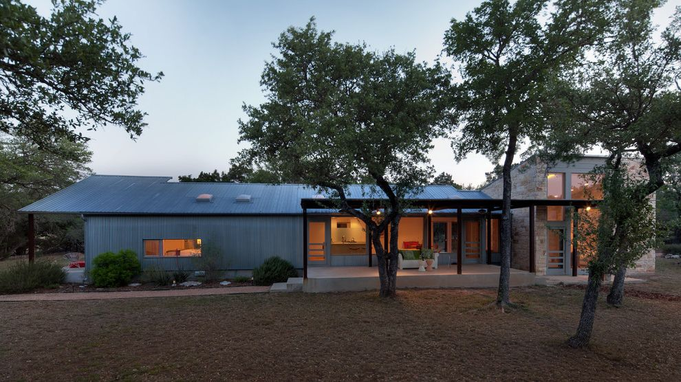 40x60 Metal Building with Living Quarters with Industrial Exterior  and Corrugated Metal Covered Patio Entrance Entry Industrial Metal Siding Minimal Path Patio Patio Furniture Pergola Roof Line Shed Roof Walkway