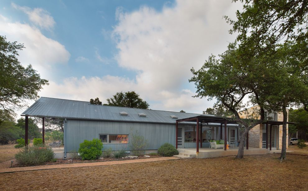 40x60 Metal Building with Living Quarters with Industrial Exterior  and Corrugated Metal Siding Covered Patio Industrial Metal Roof Minimal Path Planters Porch Walkway