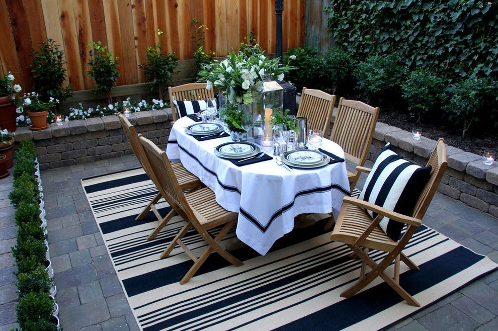 5x7 Outdoor Rug   Traditional Patio  and Black and White Brick Paving Container Plants Decorative Pillows Floral Arrangement Outdoor Dining Outdoor Rug Patio Furniture Planters Potted Plants Table Setting Tablecloth Throw Pillows Wood Fencing