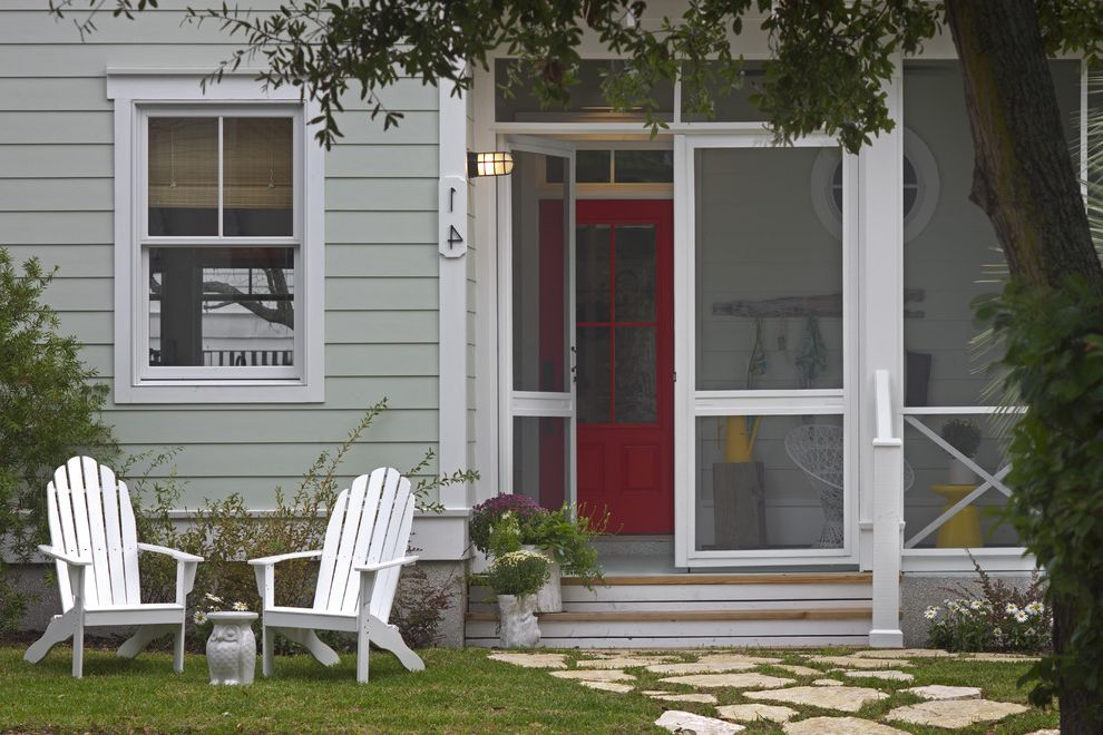 96 Screen Door   Beach Style Entry  and Adirondack Chair Double Hung Window Flagstone Gray Lap Siding Lawn Red Door Round Window Screened in Porch Transom Window Wall Sconce White Trim Yellow Accents