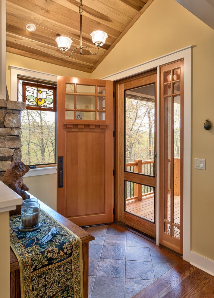96 Screen Door with Craftsman Entry  and Floor Tile Mountain Contemporary Mountain Home Natural Lighting Stained Glass Window White Trim Windows Wood Ceiling Wood Floors Yellow Walls