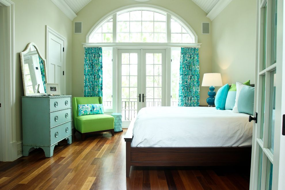 Aaa Oceanside with Beach Style Bedroom  and Aqua Arched Window Blue Curtain Panels Custom Bed Dresser French Doors Lime Green Pillows Radius Window Side Chair Table Lamp Turquoise Vaulted Ceiling Wood Floor