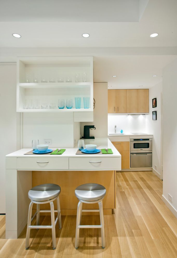 Above Range Microwave with Scandinavian Kitchen  and Apartment Counter Stools Glassware Kitchenette Light Wood Floors Micro New York City Place Settings Recessed Lighting Small Small Kitchen White Wall