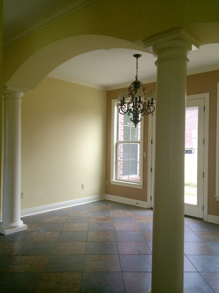 Acadian Style Homes   Eclectic Spaces Also Arched Entrance Arched Entryway Architectural Columns Ceramic Tile Custom Floor Tile Pattern Custom Millwork Home Office Indoor Outdoor Living Tuscan Columns Yellow Paint