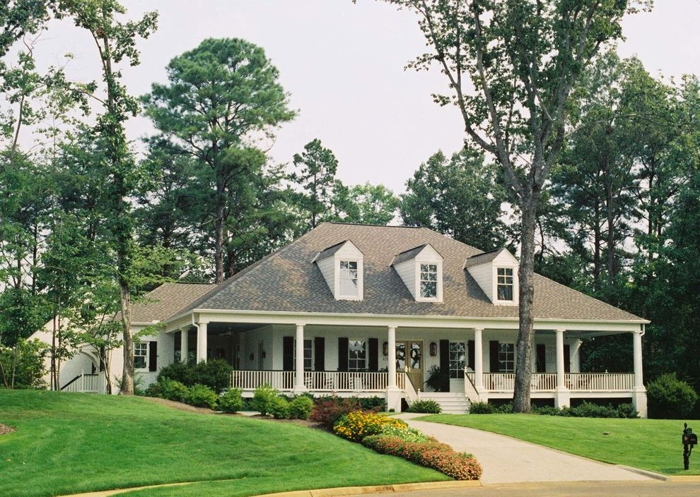 Acadian Style Homes   Traditional Exterior  and Border Plantings Dormer Windows Driveway Entrance Entry Front Door Grass Lawn Painted Wood Porch Turf White Wood Window Shutters Window Treatments Wood Column Wood Shutters Wood Siding Wrap Around Porch