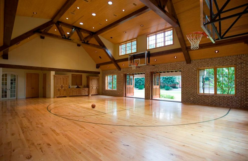 Acadian Style Homes   Traditional Home Gym  and Exposed Wood Beams Indoor Basketball Court