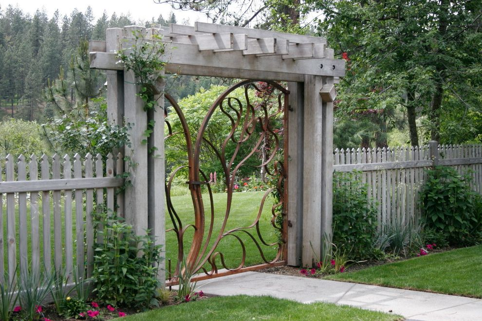 Accordion Dog Gates   Contemporary Landscape  and Arbor Concrete Sidewalk Garden Entrance Garden Entry Garden Gate Gate Metal Gate Pink Flowers Threshold Wood Fence Wrought Metal