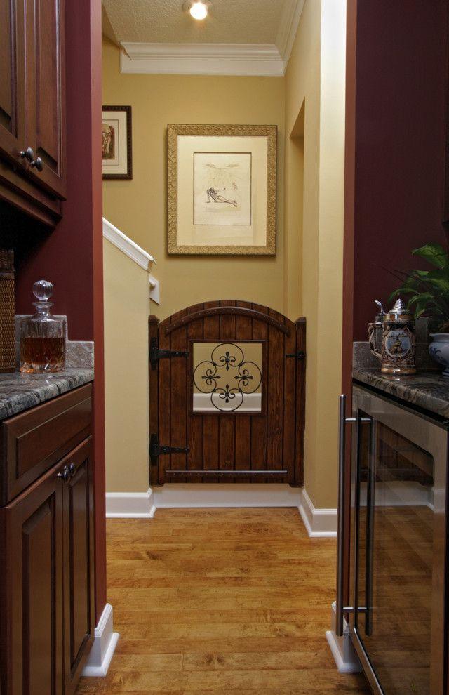 Accordion Dog Gates   Mediterranean Kitchen Also Baby Gate Butlers Pantry Iron Scrolls Olde World Wine Refrigerator Wood Floor Wood Gate