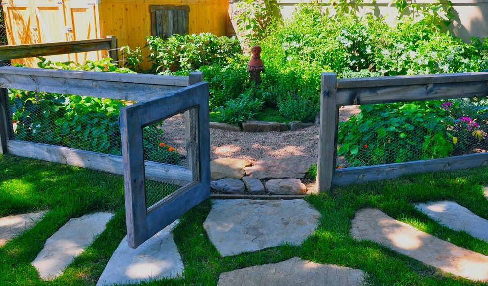 Accordion Dog Gates with Eclectic Landscape Also Chicken Wire Enclosed Garden Garden Statue Grass Lawn Pavers Reclaimed Lumber Fence Saint Turf Wood Fencing