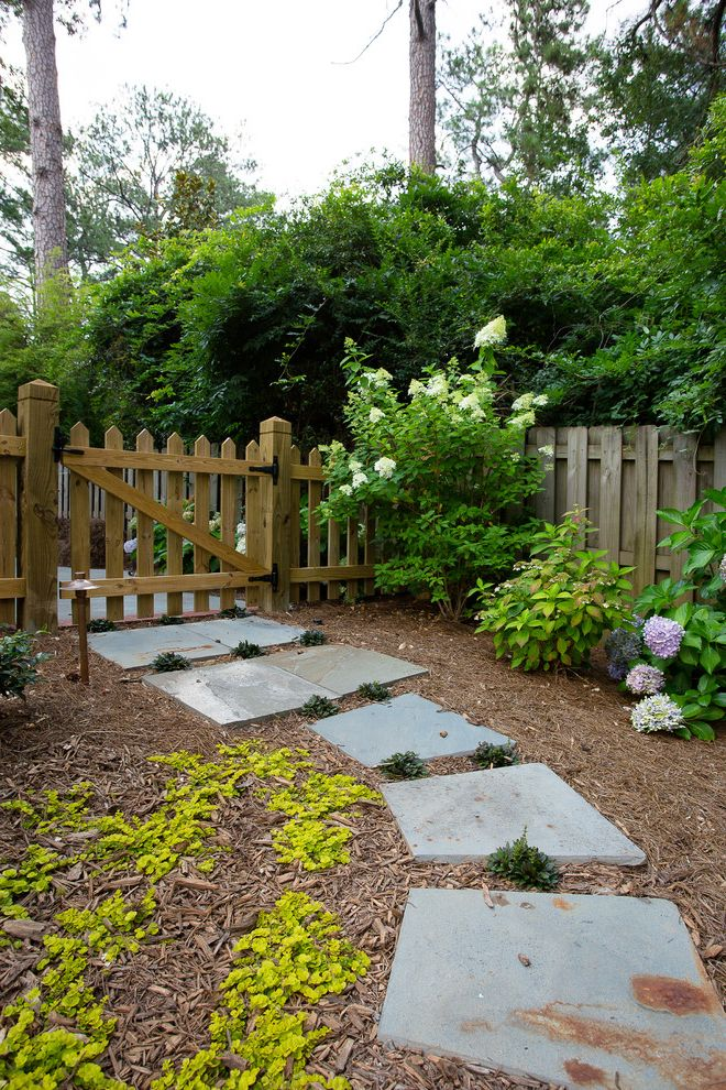 Accordion Dog Gates with Traditional Landscape Also Bark Dust Ground Cover Hydrangeas Pathway Picket Fence Stepping Stones Tanbark Walkway Wood Fence Wood Gate