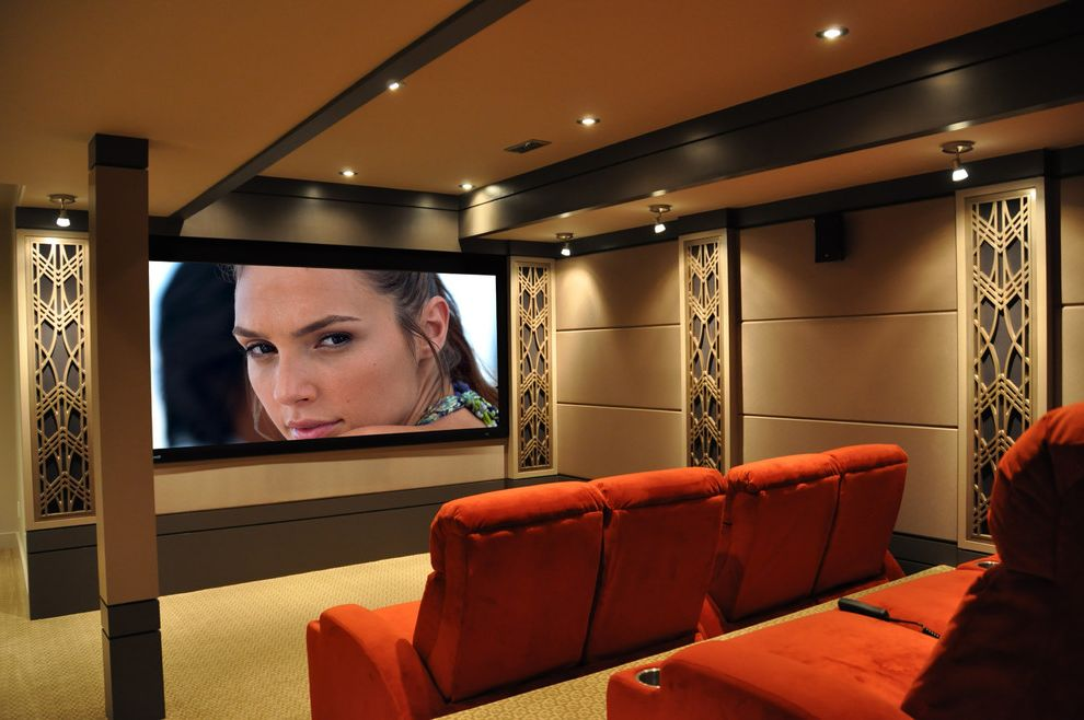 Acoustic Panel Placement with Contemporary Home Theater  and Beige Carpeting Directional Lights Gold Home Theater Movie Theater Recessed Lighting Red Armchairs Speaker Panels Theater Seating Tiered Seating Tray Ceiling