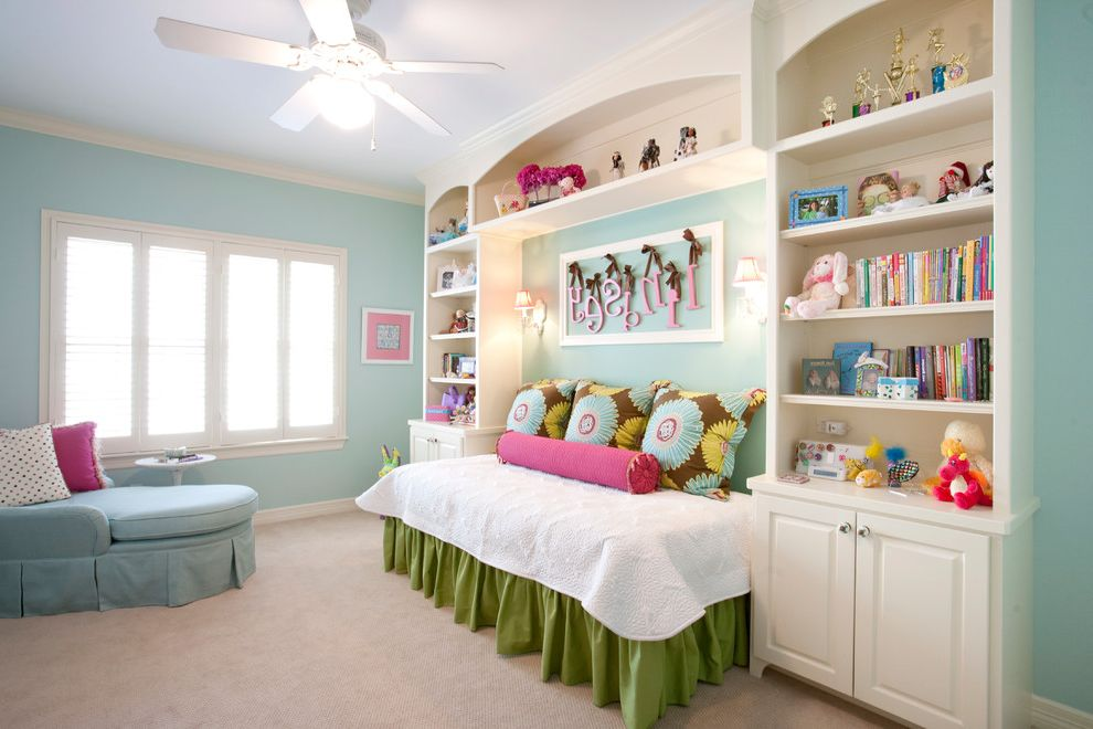 Adult Daybed with Traditional Kids  and Blue Wall Color Built Ins Built in Bookcases Chase Lounge Green and Pink Indoor Wall Sconce Kids Bedroom Magenta Bolster Pillow Pink Accent Pillows Pink and Brown Color Scheme Pokadot Pillow White Ceiling Fan