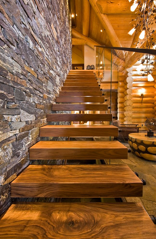 Advanced Distribution Services   Rustic Staircase Also Cantilevered Stairs Exposed Beams Floating Stairs Glass Panel Banister Glass Panel Railing Stone Wall Straight Run Stairs Structural Beams Wooden Stairs