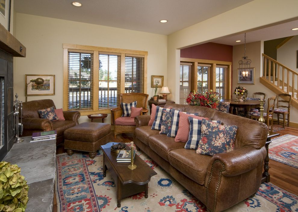 Affordable Leather Couches with Traditional Living Room  and Area Rug Brown Leather Couches Christian Gladu Design Dining Area Fireplace Nail Head Detail Natural Wood Trim Pillows Sisters Oregon Staircase Stone Hearth the Bungalow Company