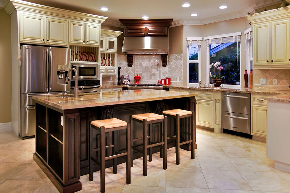 Airport Appliance San Jose   Mediterranean Kitchen Also Bay Window Counter Stools Dark Stained Wood Dishwasher Drawers Granite Island Kitchen Island Marble Raised Panel Cabinets Rush Seats Stainless Stell Appliances Tile Backsplash Tile Floor