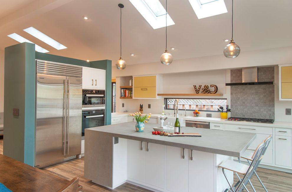 Airport Appliance San Jose with Contemporary Kitchen Also Blue Wall Chalkboard Paint Concrete Countertop Gray Countertop Great Room Kitchen Island Skylights Wood Like Tiles in Great Room Wooden Shelves in Kitchen Yellow Upper Kitchen Cabinets