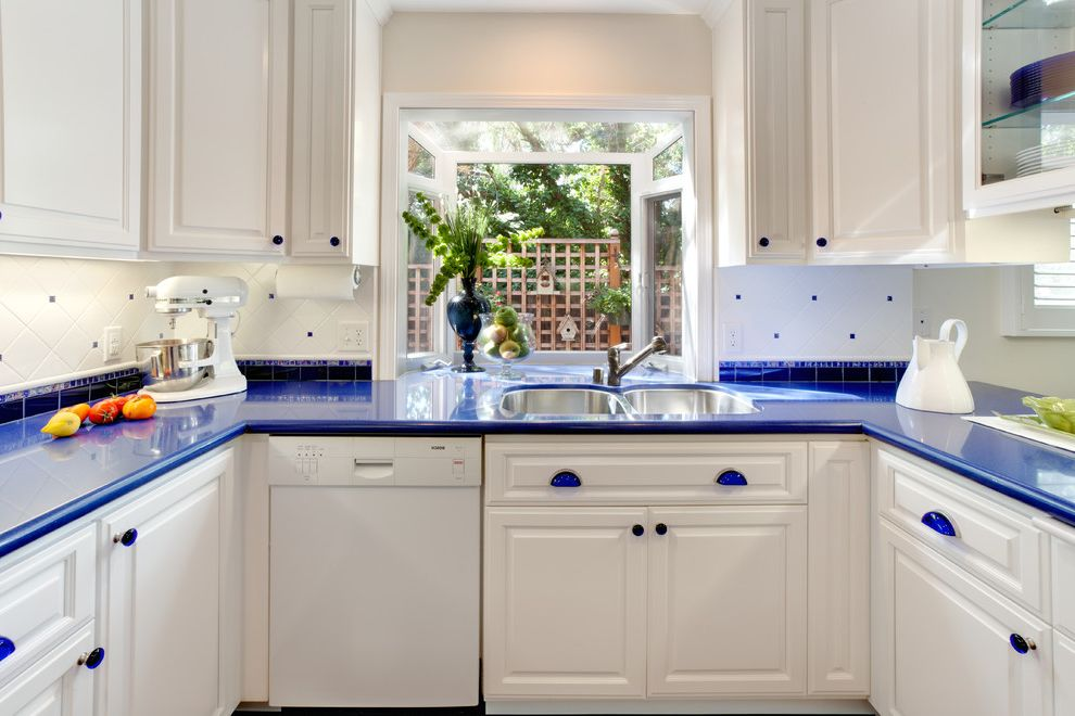 Airport Appliance San Jose with Traditional Kitchen Also Blue Counters Blue Drawer Pulls Glass Front Cabients Lattice Fence Over Sink Window Raised Panel Woodwork Tile Backsplash White Appliances White Cabinets