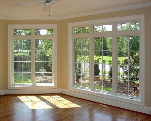 Alderfer Glass   Traditional Living Room Also Beige Walls Living Room Large Windows Living Room White Window Trim Wood Floor Living Room