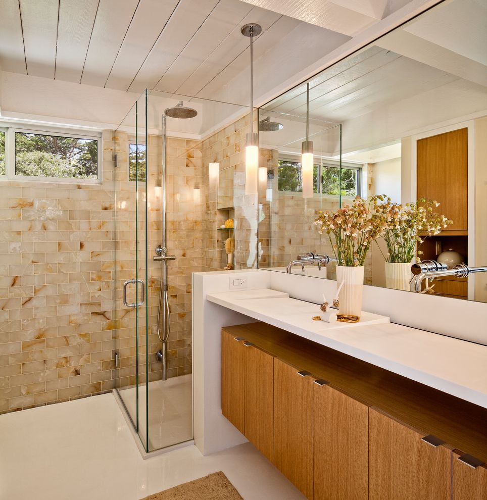 Alexandria of Carmel Apartments with Midcentury Bathroom Also Double Sinks Double Vanity Earth Tones Exposed Beams Frameless Shower Enclosure Infinity Sink Shared Bathroom Shower Tile Subway Tile Wall Mount Faucet Wood Cabinets Wood Ceiling