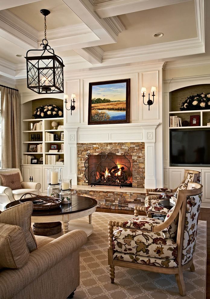 Alexandria of Carmel Apartments with Traditional Living Room Also Brown Sofa Built in Bookcase Coffered Ceiling Framed Artwork Patterned Armchair Pendant Light Wall Sconces