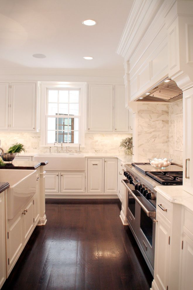 All Rite Plumbing with Traditional Kitchen  and Apron Sink Ceiling Lighting Crown Molding Dark Floor Farm Sink Kitchen Island Range Hood Recessed Lighting Stainless Steel Appliances Under Cabinet Lighting White Kitchen Wood Flooring