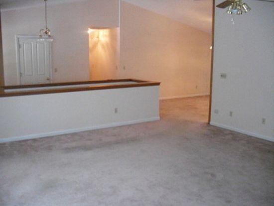 Allstar Management with  Living Room  and Carpet Flooring Hanging Chandelier Living Room Remodel White Walls