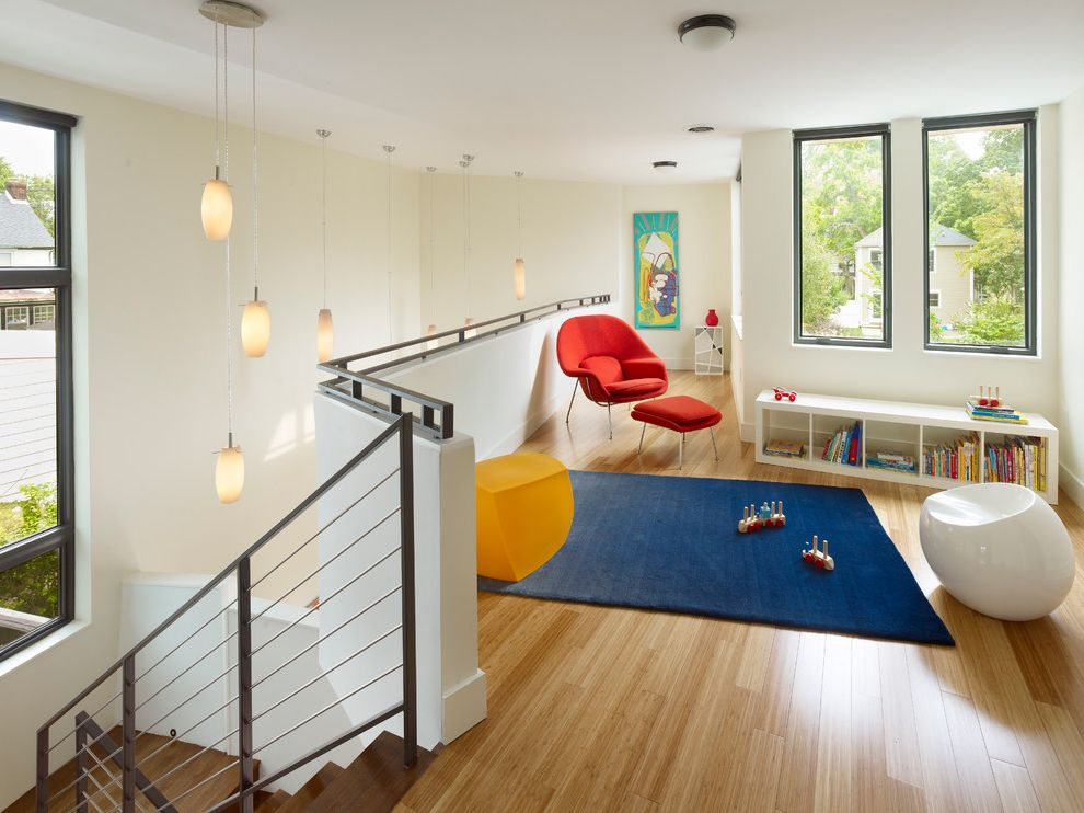 Alternatives to Hardwood Floors   Modern Kids Also Art Blue Rug Bookcase Cable Railing Hall High Ceiling Kids Play Room Loft Orange Armchair Pendant Light Rug Stairs Wood Floor