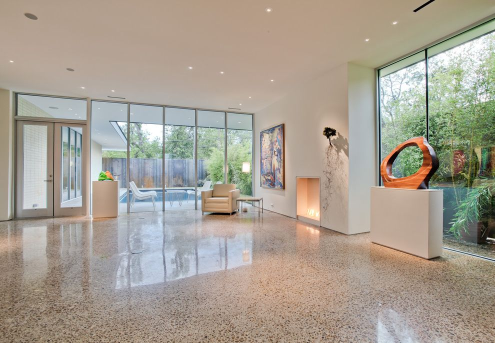 American Concrete Supply   Modern Living Room  and Gallery Glass Doors Glass Wall Large Window Modern Fireplace Pool Sculpture Terrazzo White Leather Chair White Walls