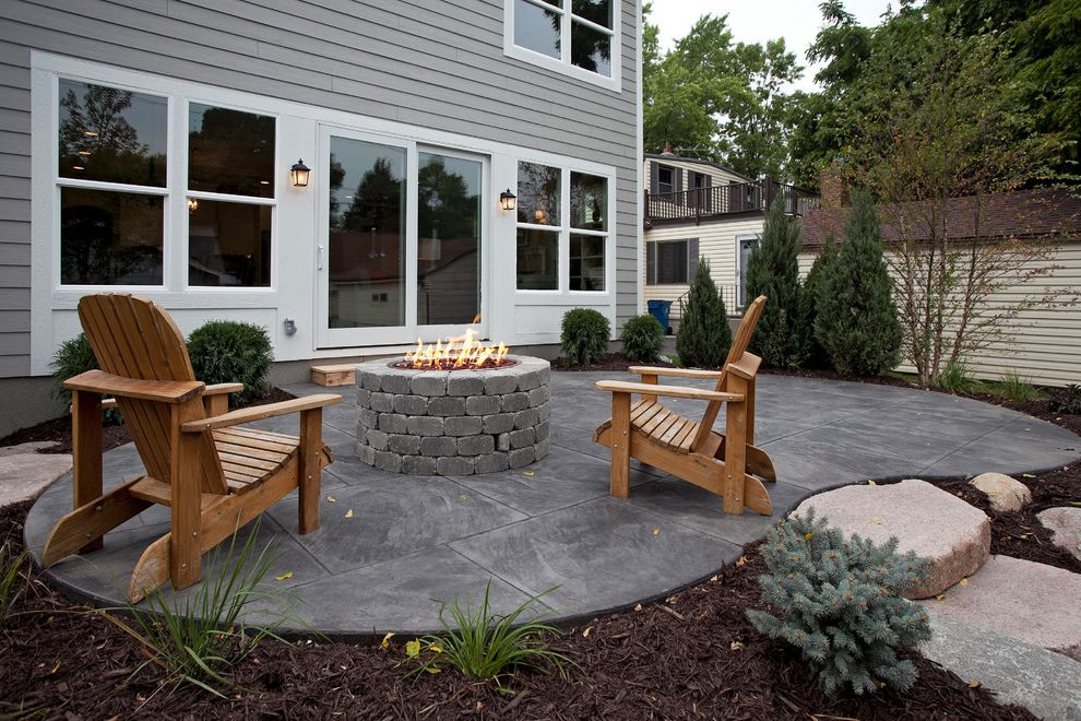 American Concrete Supply   Traditional Patio  and Adirondack Chairs Firepit Gray House Sliding Glass Door Stamped Concrete Patio White Trim