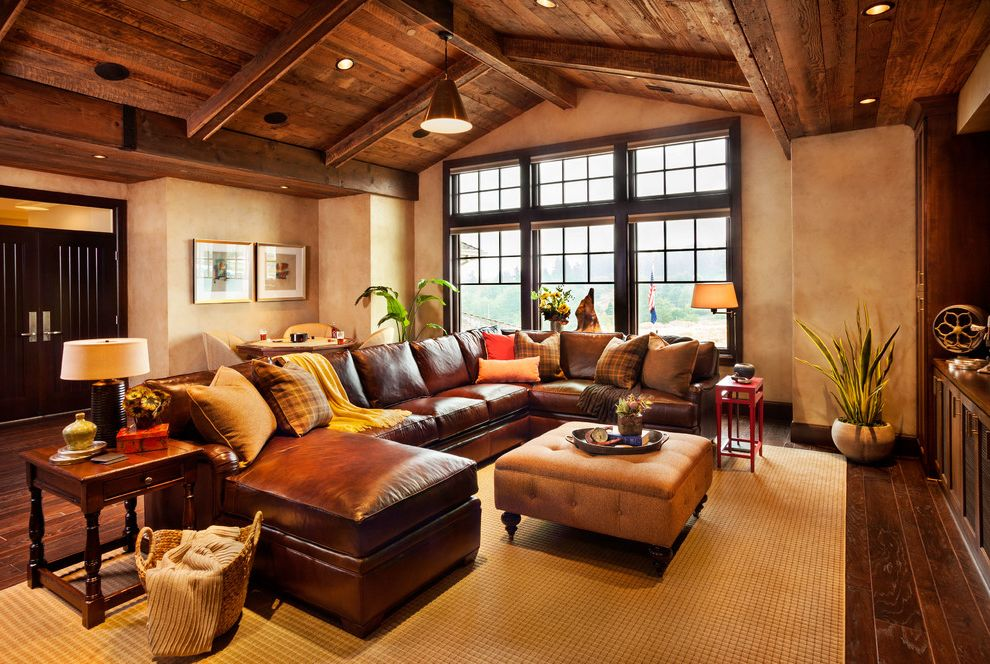 American Freight Sofas   Rustic Family Room  and Brown Leather Sofa Brown Sectional Sofa Dark Wood Floor Hardwood Floor Industrial Pendant Leather Sofa Media Room Potted Plat Reclaimed Barnwood Seating Wood Ceiling