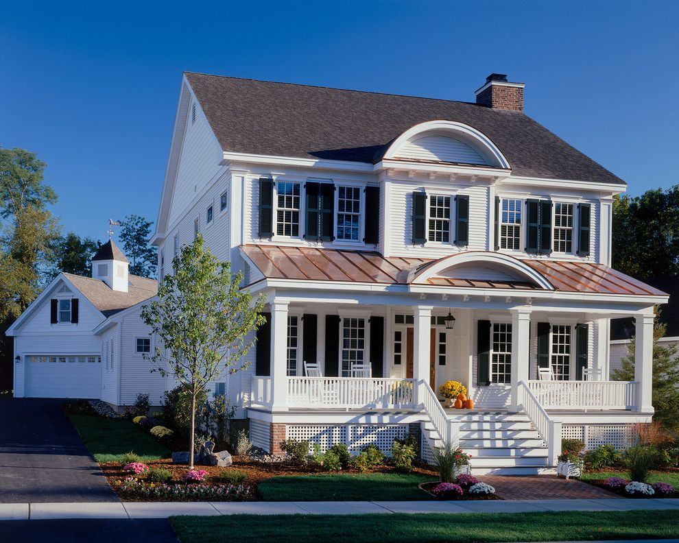 American Roofing Utah with Traditional Exterior  and Black Shutters Brick Path Chimney Columns Covered Porch Gable Roof Landscaping Lattice Metal Roof Rocking Chairs Weathervane