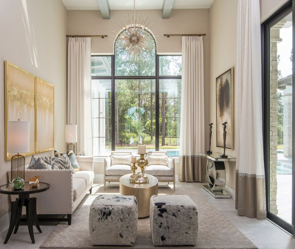 American Signature Furniture Tampa   Transitional Living Room Also Arched Window Beamed Ceiling Cowhide Ottoman Elegant Framed Art Glamourous High Ceiling Mirrored Console Table Nailhead Trim Palladian Window Transitional White Curtains