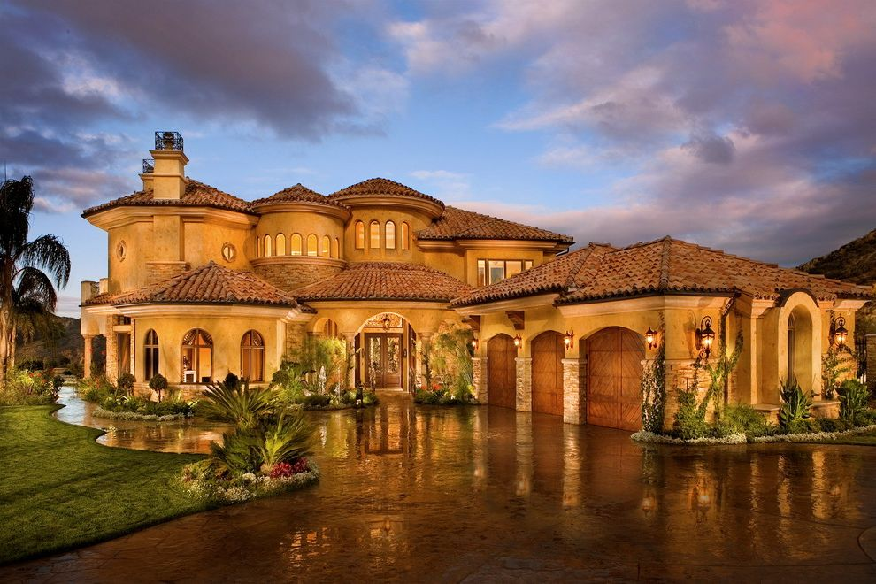 Americas Best Home Plans with Mediterranean Exterior and Arch Driveway Entrance Entry Front Door Garage Door Grass Lantern Lawn Outdoor Lighting Palm Tree Path Planter Porch Sconce Stacked Stone Tile Roof Turf Turret Walkway Wall Lighting