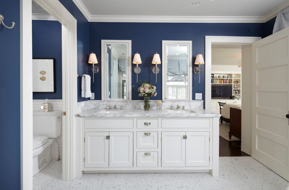 Americas Best Home Plans with Traditional Bathroom and Blue Crown Molding Cup Drawer Pulls Double Vanity Five Panel Door Marble Counters Marble Floor Mirrors Navy Wall Sconces White Frame and Panel Cabinets