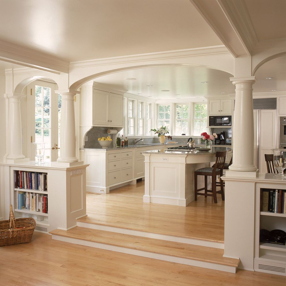 Americas Best Home Plans with Traditional Kitchen and Archway Bookcase Bookshelves Built in Shelves Eat in Kitchen Exposed Beams Sunken Living Room White Kitchen White Wood Wood Flooring Wood Molding