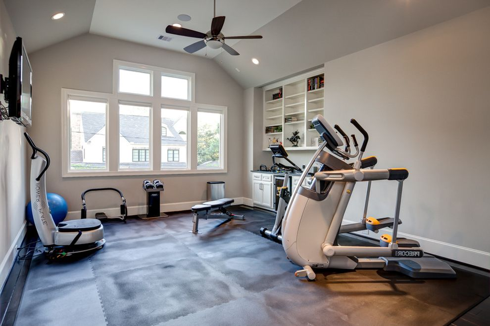 Amigo Power Equipment   Contemporary Home Gym Also Built in Cabinets Ceiling Fan Exercise Equipment Home Gym Interlocking Mats Light Gray Vaulted Ceiling Wall Mounted Tv White Casing White Walls Windows Workout Room