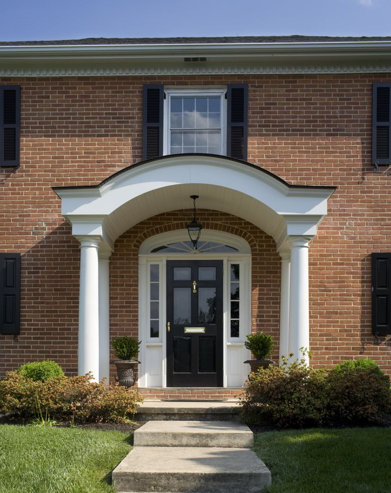 Anderson Front Doors   Traditional Entry  and Brick House Brick Walls Columns Container Plants Decorative Garden Urns Front Door Front Porch Grass Lanterns Lawn Mail Slot Portico Potted Plants Sidelights Topiaries Transom Turf Window Shutters